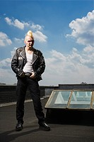 Portrait of mid-adult punk standing on roof