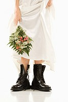 Bride holding bouquet down by her black combat boots