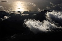 Aerial view of mountains with clouds by Pacific ocean on Maui, Hawaii