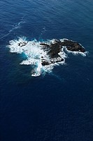 Aerial of rock in Pacific ocean off coast of Maui, Hawaii