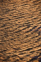Aerial of rippled Atlantic ocean water with sun reflection