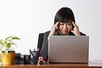 business woman looking stressed at computer