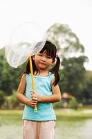girl holding a butterfly net