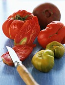 Tomatoes, one sliced with paring knife (thumbnail)