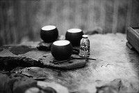 Tea cups placed on rock surface