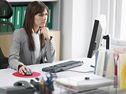 Worried Female Office Worker at Desk (thumbnail)