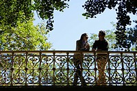 Couple talking on bridge low angle view
