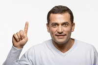 Mid adult man holding index finger up