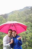 Couple hugging under umbrella