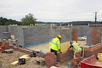 Bricklayers on a house building site (thumbnail)