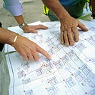 Building technicians looking at plans, Housing development, England