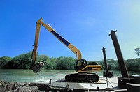 Excavator during dredging excavations