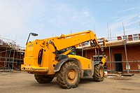 Rear view of forklift on house building site (thumbnail)