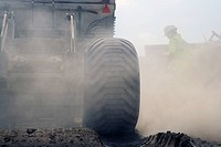 View of large truck and dust during roadwork operations