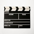 Movie scene clapboard with blank copy space against white background (thumbnail)