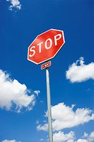 Stop sign with blue cloudy sky (thumbnail)