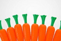 Bunch of carrots lined up on white background