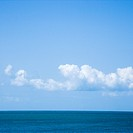 Ocean and sky with low cumulus clouds