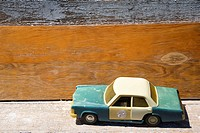 Toy police car on wooden shelf