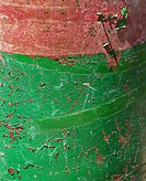 Closeup of green and red rusted container