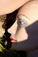 Closeup of face of mannequin on ground