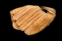 Baseball glove on black.