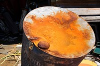 Old weathered oil barrel with rusty top