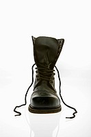 One black leather high top boots with untied laces