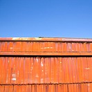 Metal orange siding and blue sky