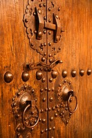Wooden doors with ornate metal knobs and locks