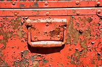 Old orange weathered metal storage container