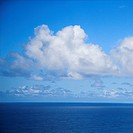 Pacific ocean and blue sky with puffy clouds