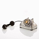 Rotary telephone with receiver to the side