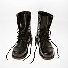 Black leather boots with laces untied