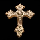 Ornamental religious cross against black background.