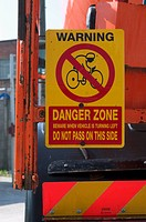 Warning sign on a side of a crane