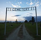 Sign over entrance to cemetary at dusk in rural South Dakota (thumbnail)