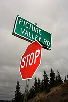 Stop sign and sign reading Picture Valley Rd