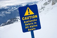 Snow ski resort caution sign on mountain side