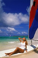 Woman on beach with sailboat, Punta Cana, Dominican Republic, Caribbean