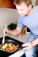 man cooking a dinner