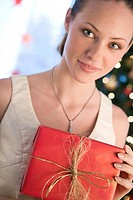 portrait of a woman with christmas gift