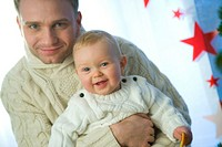 christmas portrait of father and baby