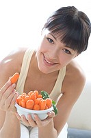 Woman with bowl of carrots (thumbnail)
