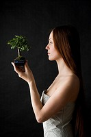 Beauty woman with bonsai tree (thumbnail)