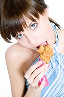 young woman eating chicken nuggets