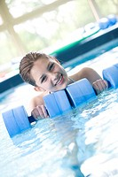 Young woman doing exercise in swimming pool (thumbnail)