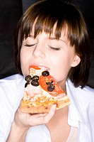 young woman with pizza piece