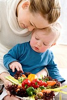 mum and infant with vegetable plate