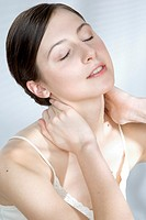 young woman massaging neck